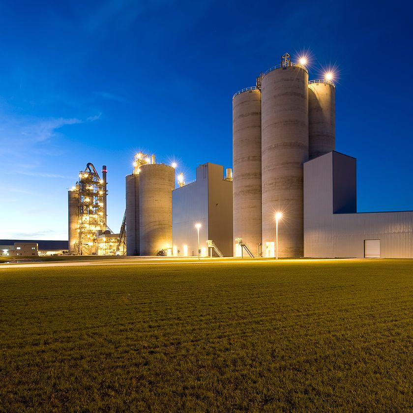 CRH cement production facility illuminated at night