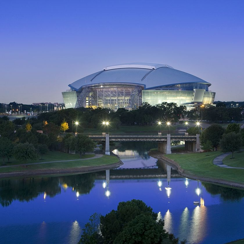 Dallas Cowboys AT&T stadium built with CRH materials illuminated at night