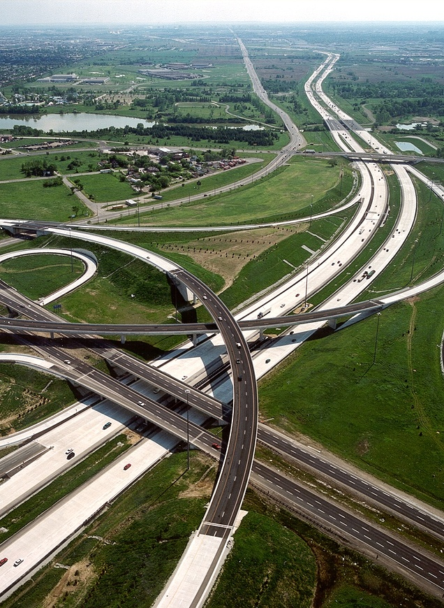 Busy highway system with green land surrounding