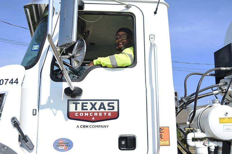 CRH employee and former military member driving a Texas Concrete truck